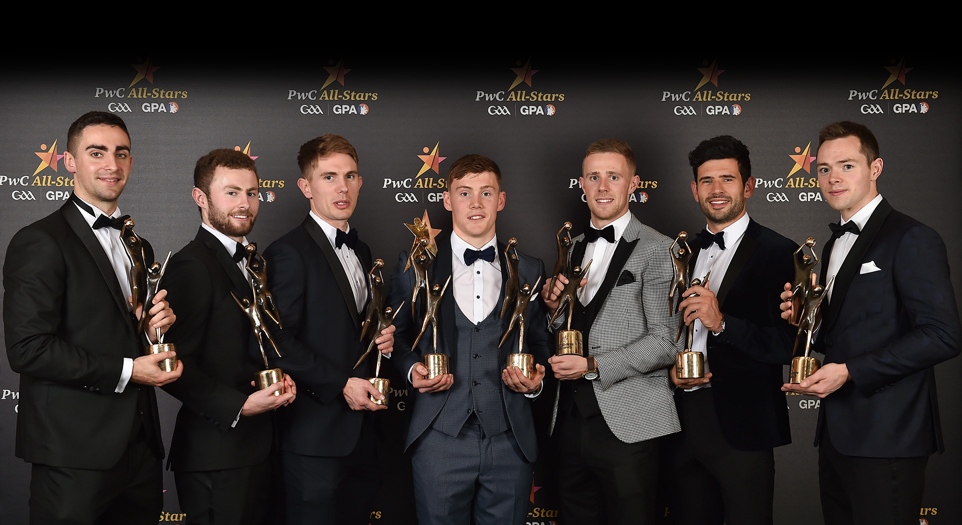 Dublin footballers, from left, James McCarthy, Jack McCaffrey, Michael Fitzsimons, Con O'Callaghan, Paul Mannion, Cian O'Sullivan and Dean Rock pictured with their awards during the PwC All Stars 2017 at the Convention Centre in Dublin. All wearing Collar & Cuff